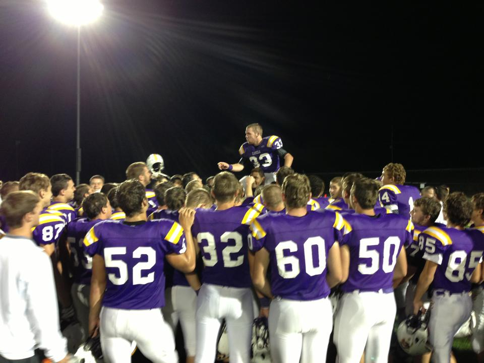 Senior Joe Kremer leads the fight song after the game