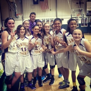 Girls freshman basketball celebrate after winning the district tournament