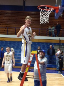 Jordan Day cutting down the nets after the regional win.