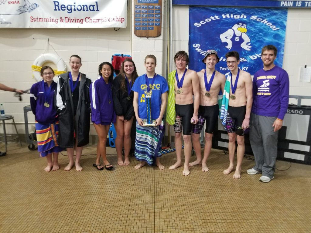 Campbell County Swimmer with the gold medal meet trophy