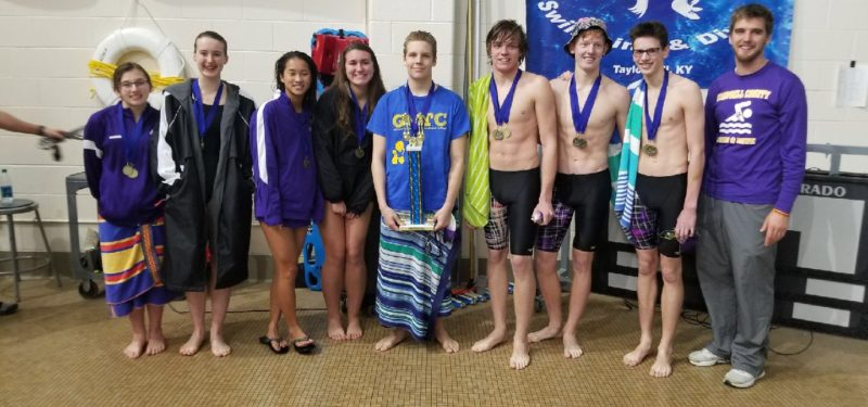 Campbell County Swimmers with the gold medal meet trophy