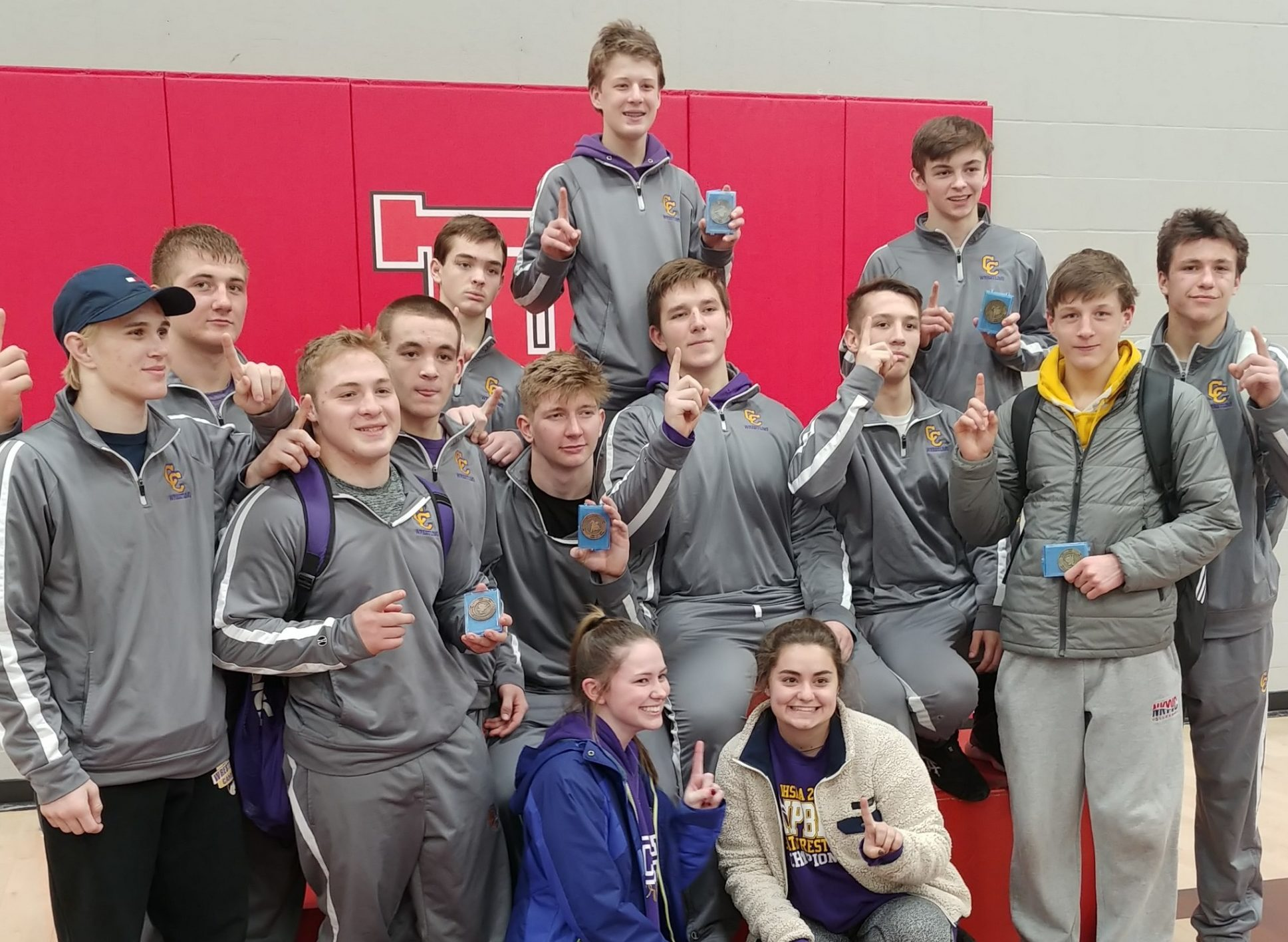 The campbell county wrestling team caputes their 27th nkac conference title